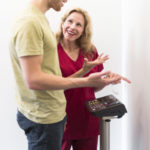 Dr. Ghislaine Robert with a patient discussing body composition measurement