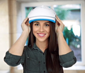 Woman wearing a Theradome Professional Laser Hair Helmet